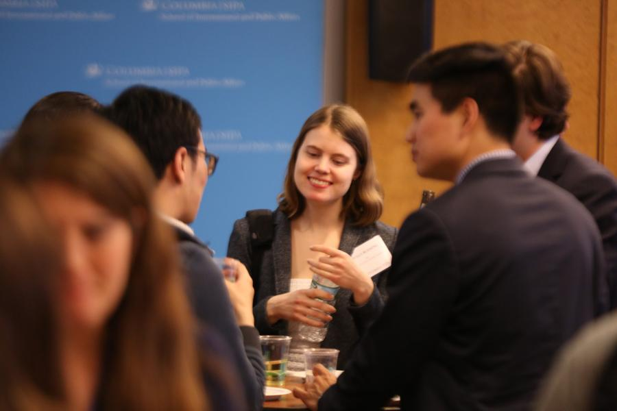 Students speaking at networking event