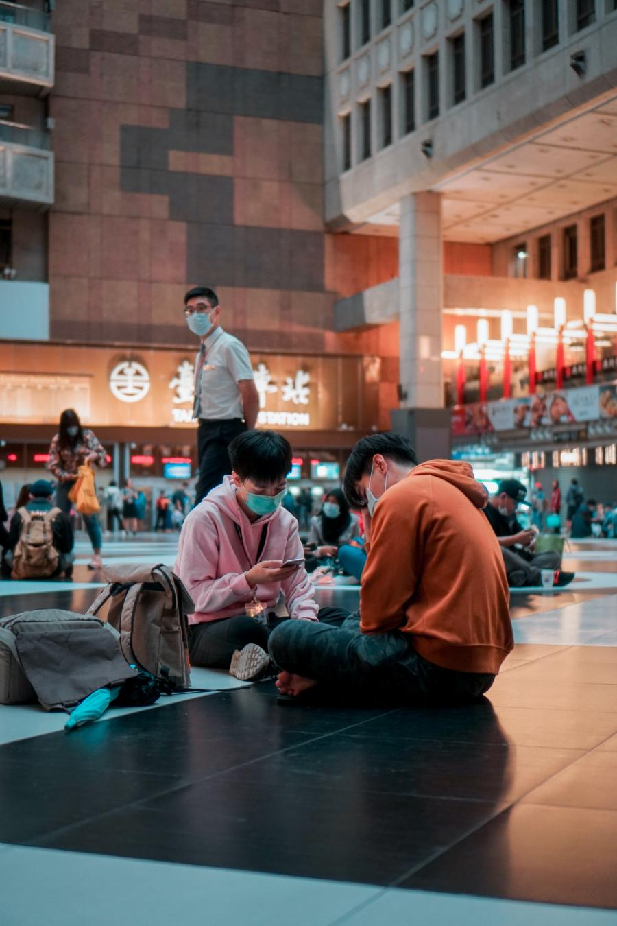 people wear masks at a train station in Taipei, Taiwan