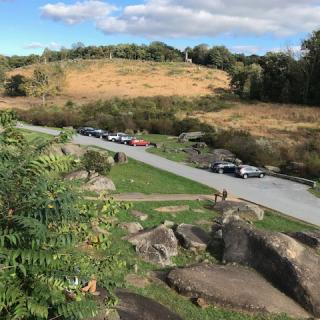 "Students analyzed the Union defense of locations like Little Round Top, seen here from the perspective of ""Devil's Den,"" a rock formation from which Confederate troops launched an attack."